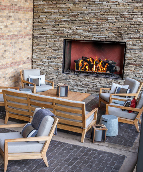 outdoor open gas fireplace with logs at four seasons resort bar