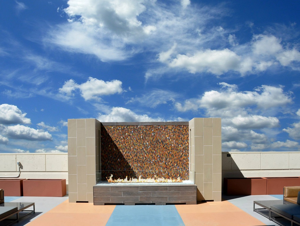 outdoor fire table with mosaic backdrop rooftop patio