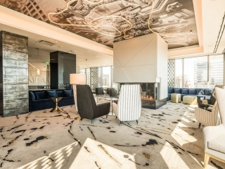 ultra modern 3-sided gas fireplace in modern lounge