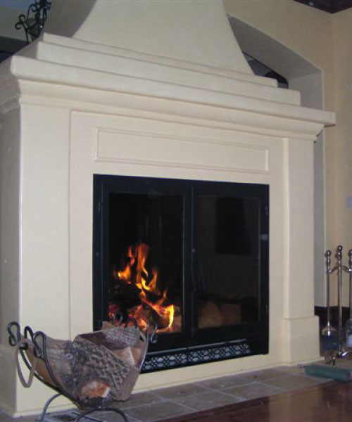 large see through wood fireplace with white surround
