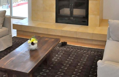 high tech efficient wood burning fireplace in modern living room