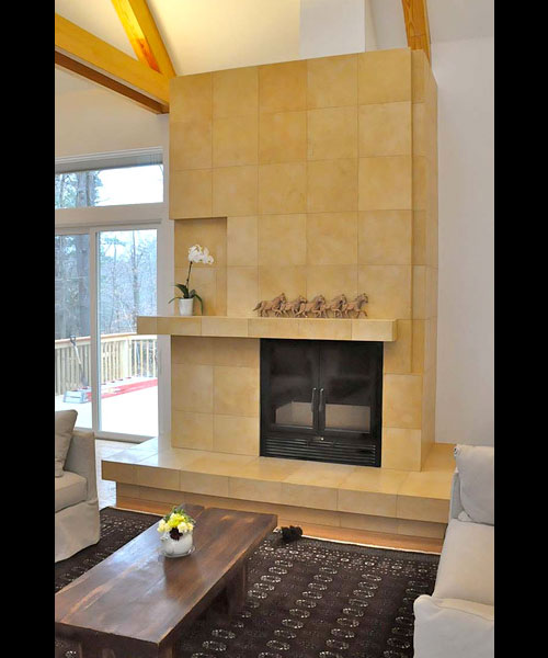 single sided wood burning fireplace with tile finish in living room