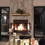 see through wood burning fireplace in living room