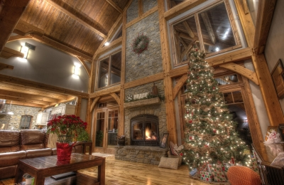 indoor outdoor see through wood burning fireplace at christmas time living room