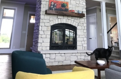 see through wood burning fireplace in modern home