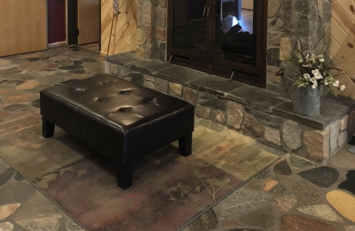 large see through wood burning fireplace with stone surround