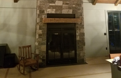 large single sided wood burning fireplace in private residence