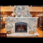 single sided wood burning fireplace with stone surround