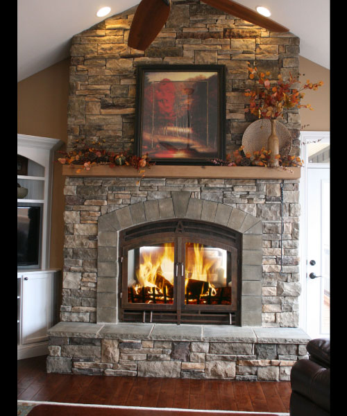 see through wood burning fireplace with stone finish
