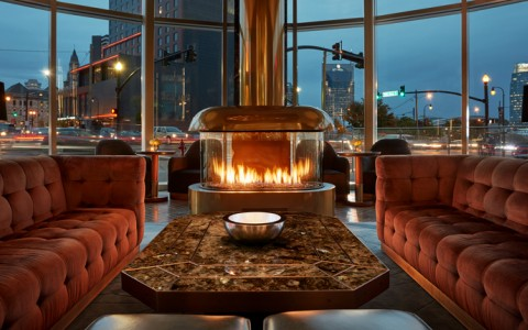 3 sided round glass fireplace in nashville hotel lounge
