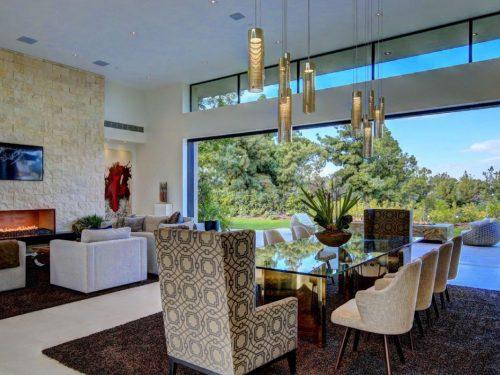 linear open gas fireplace in modern living room
