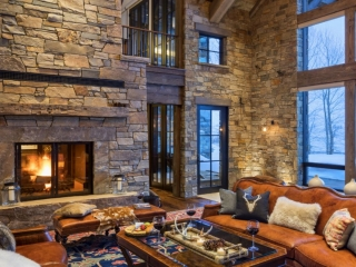 see through wood burning fireplace with clean face in rustic living room