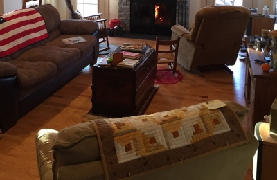 see through wood burning fireplace with steel doors