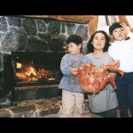cooking in wood burning fireplace with family