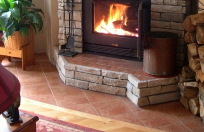 high tech efficient wood burning fireplace in cabin living room