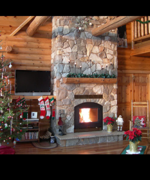 single sided wood burning fireplace with christmas tree