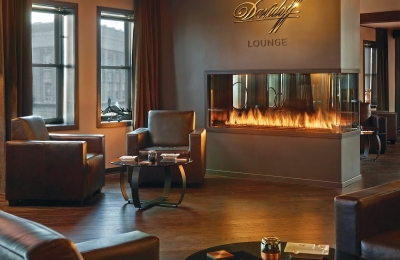 3 sided glass fireplace in cigar lounge