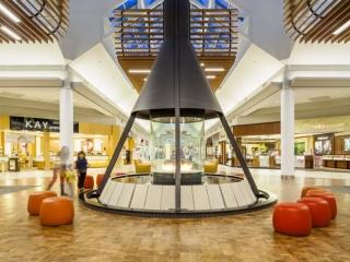 circular gas fireplace in shopping mall