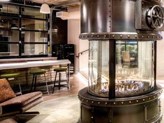 circular gas fireplace in apartment lounge