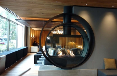 custom gas circular fireplace with linear burner in hotel lobby