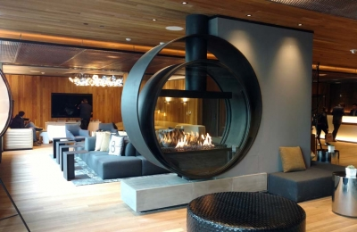 concentric circular gas fireplace in california hotel lobby
