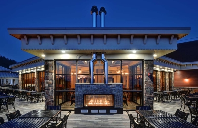indoor outdoor see through gas fireplace at a ski resort restaurant