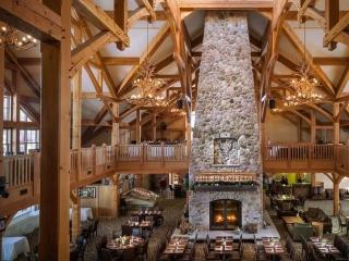 Custom four sided wood burning fireplace at Vermont ski resort