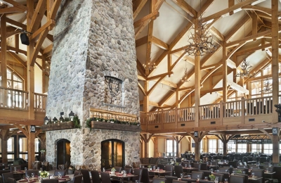custom four sided wood burning fireplace in Vermont ski resort dining hall