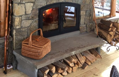 indoor outdoor see through wood burning fireplace exterior side of home