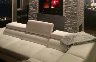 see through double sided wood burning fireplace with white stone surround