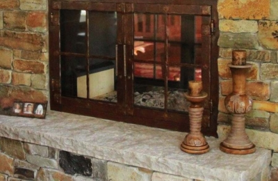 see through double sided wood burning fireplace with strapping and grids