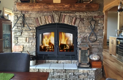 see through double sided wood burning fireplace with real stone surround
