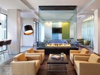 four sided glass fireplace in apartment lounge