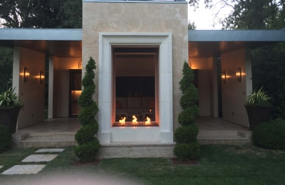 outdoor open gas fireplace with torch burner