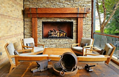 custom outdoor fireplace with logs