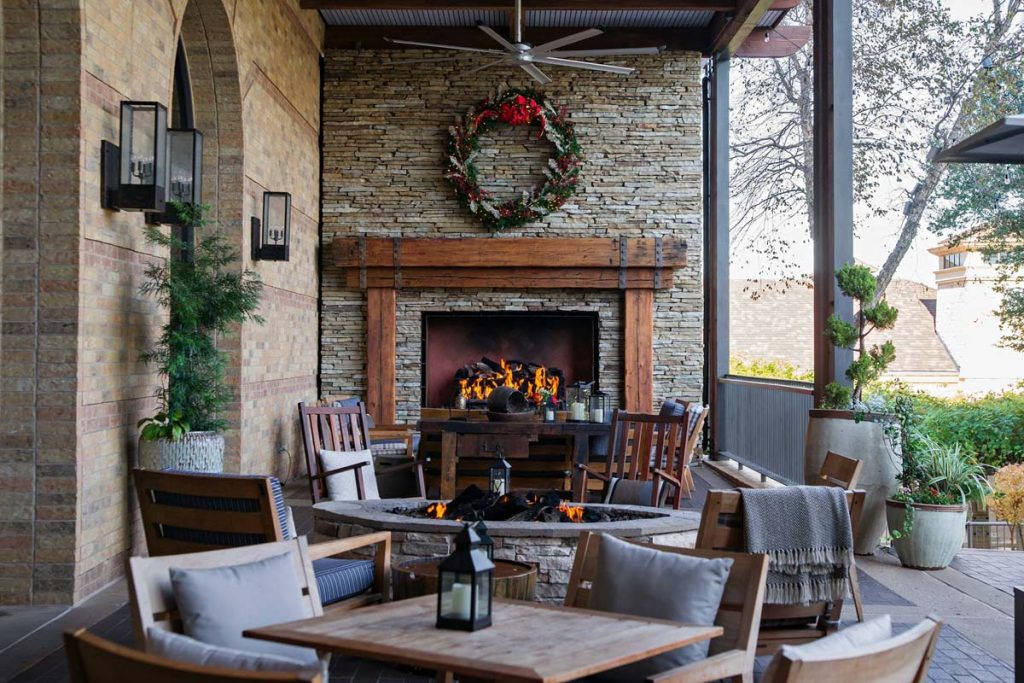 outdoor gas fireplace with mammoth logs in dining area of four seasons