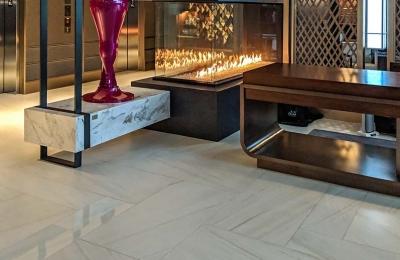 three sided peninsula gas fireplace in hotel lobby