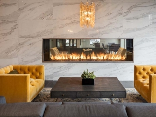 linear see through gas fireplace in apartment lobby