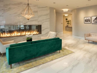 linear see through double sided gas fireplace in modern lobby