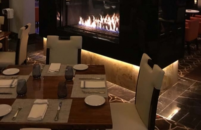linear see through gas fireplace in las vegas restaurant