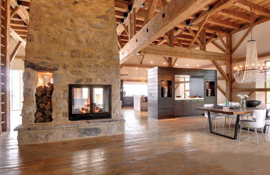see through double sided wood fireplace in modern open floor plan