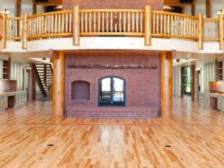 custom see through double sided wood burning fireplace with red brick surround