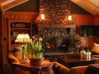 single sided wood burning fireplace in living room