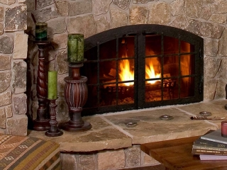 custom wood burning fireplace with strapping and hammered finish