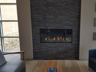 single sided linear gas fireplace in lobby of health center