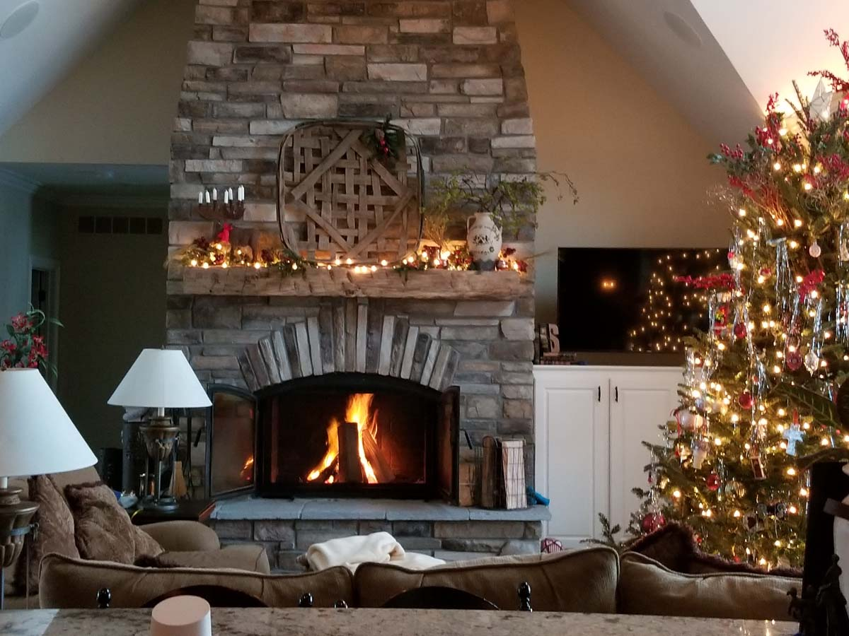 winter wood burning fireplace with christmas tree