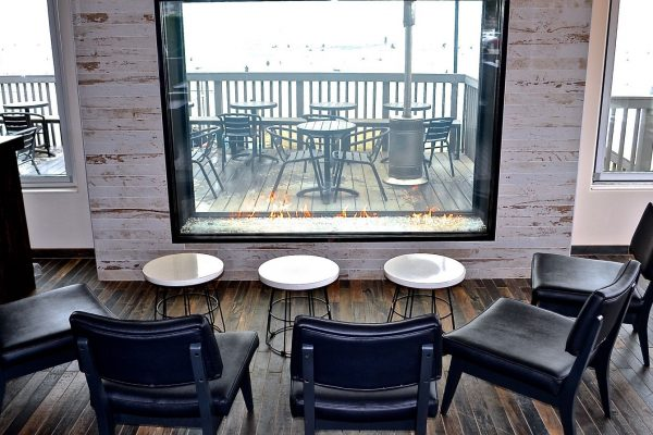 indoor outdoor see through gas fireplace overlooking the beach