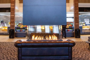 four sided indoor gas fireplace emagine theater