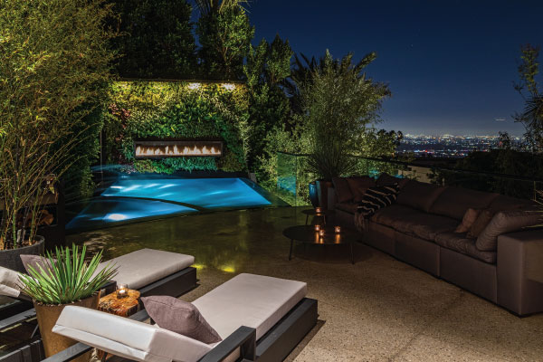 outdoor gas fireplace above pool