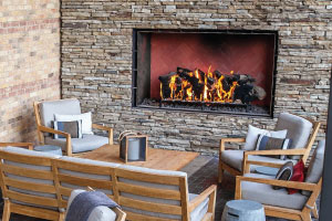 outdoor open linear gas fireplace with logs